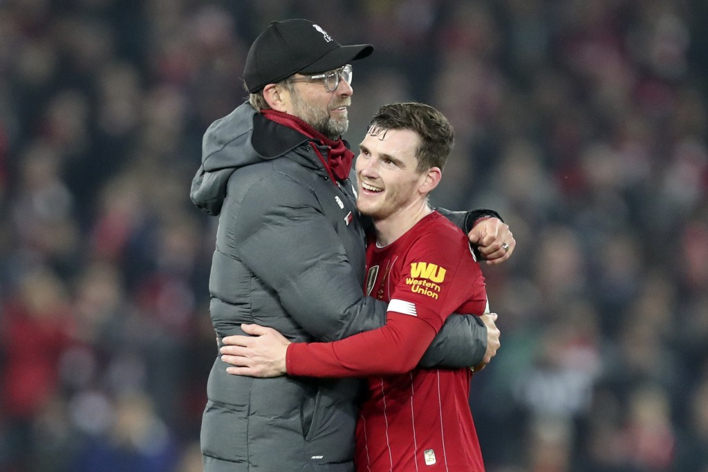 Liverpool's manager Jurgen Klopp embraces Liverpool's Andrew Robertson at the end of the English Premier League soccer match between Liverpool and Wol...