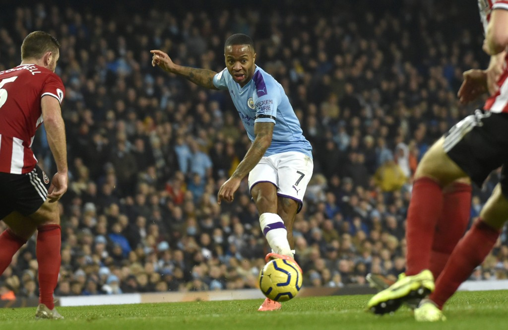 Manchester City's Raheem Sterling takes a shot during the English Premier League soccer match between Manchester City and Sheffield United at Etihad s...