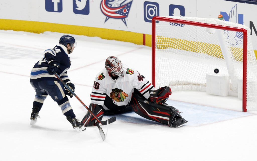 Chicago Blackhawks goalie Robin Lehner, right, of Sweden, stops a shot by Columbus Blue Jackets forward Nathan Gerbe during an overtime period of an N...