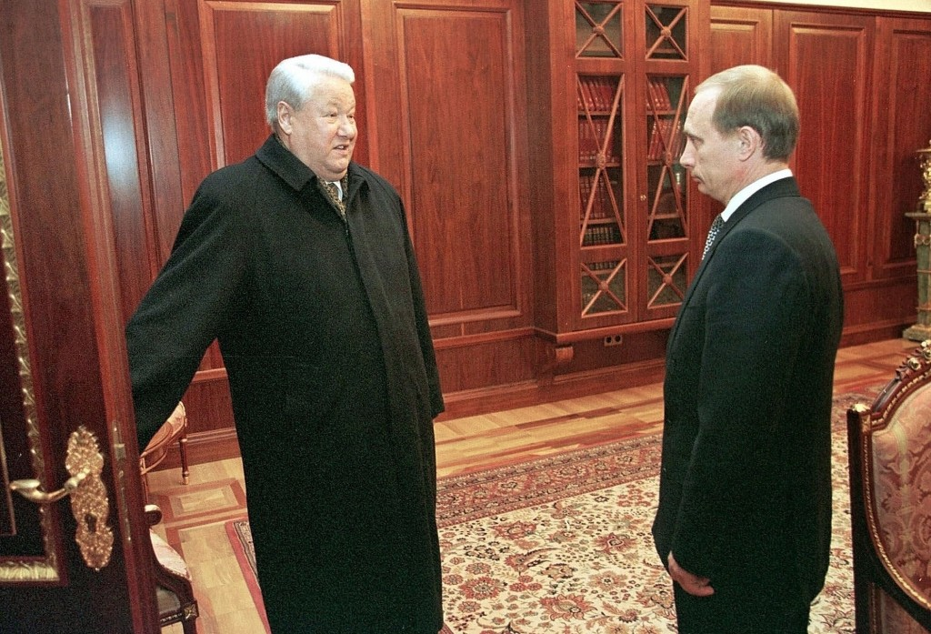 FILE In this file photo taken on Friday, Dec. 31, 1999, Former President Boris Yeltsin smiles as he talks to the then Russian acting President and Pre...