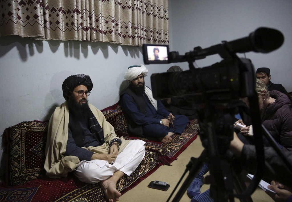 In this Saturday, Dec. 14, 2019, photo, Maulvi Niaz Mohammad, 45, left, speaks during an interview with The Associated Press inside the Pul-e-Charkhi ...