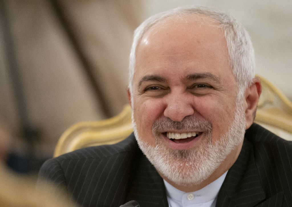 Iranian Foreign Minister Mohammad Javad Zarif smiles as he speaks to Russian Foreign Minister Sergey Lavrov during their talks in Moscow, Russia, Mond...