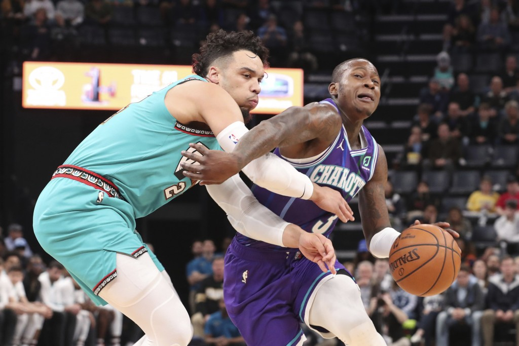 Memphis Grizzlies guard Dillon Brooks (24) defends against Charlotte Hornets guard Terry Rozier (3) in the first half of an NBA basketball game Sunday...