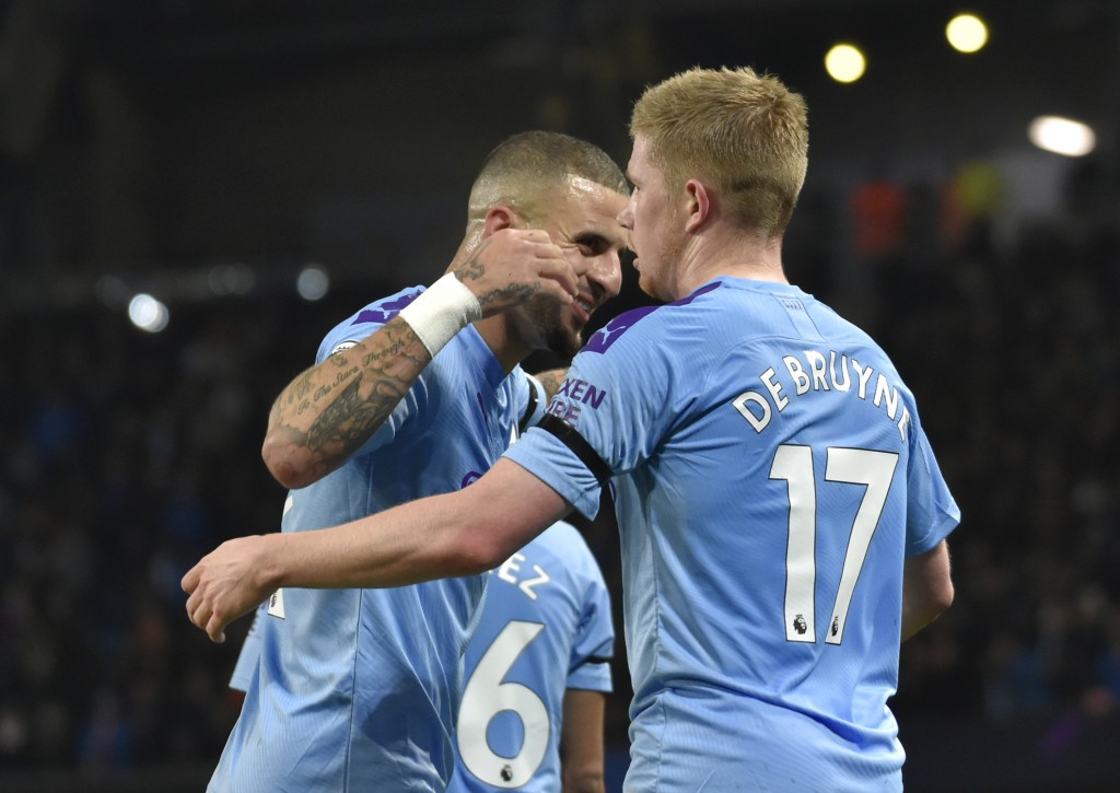 Manchester City's Kevin De Bruyne, right, celebrates with Manchester City's Kyle Walker after scoring his side's second goal during the English Premie...