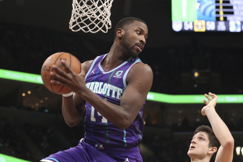 Charlotte Hornets forward Michael Kidd-Gilchrist (14) grabs a rebound in the first half of an NBA basketball game against the Memphis Grizzlies, Sunda...