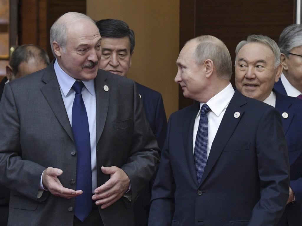 FILE In this file photo taken on Wednesday, May 29, 2019, Russian President Vladimir Putin, right, and Belarusian President Alexander Lukashenko talk ...