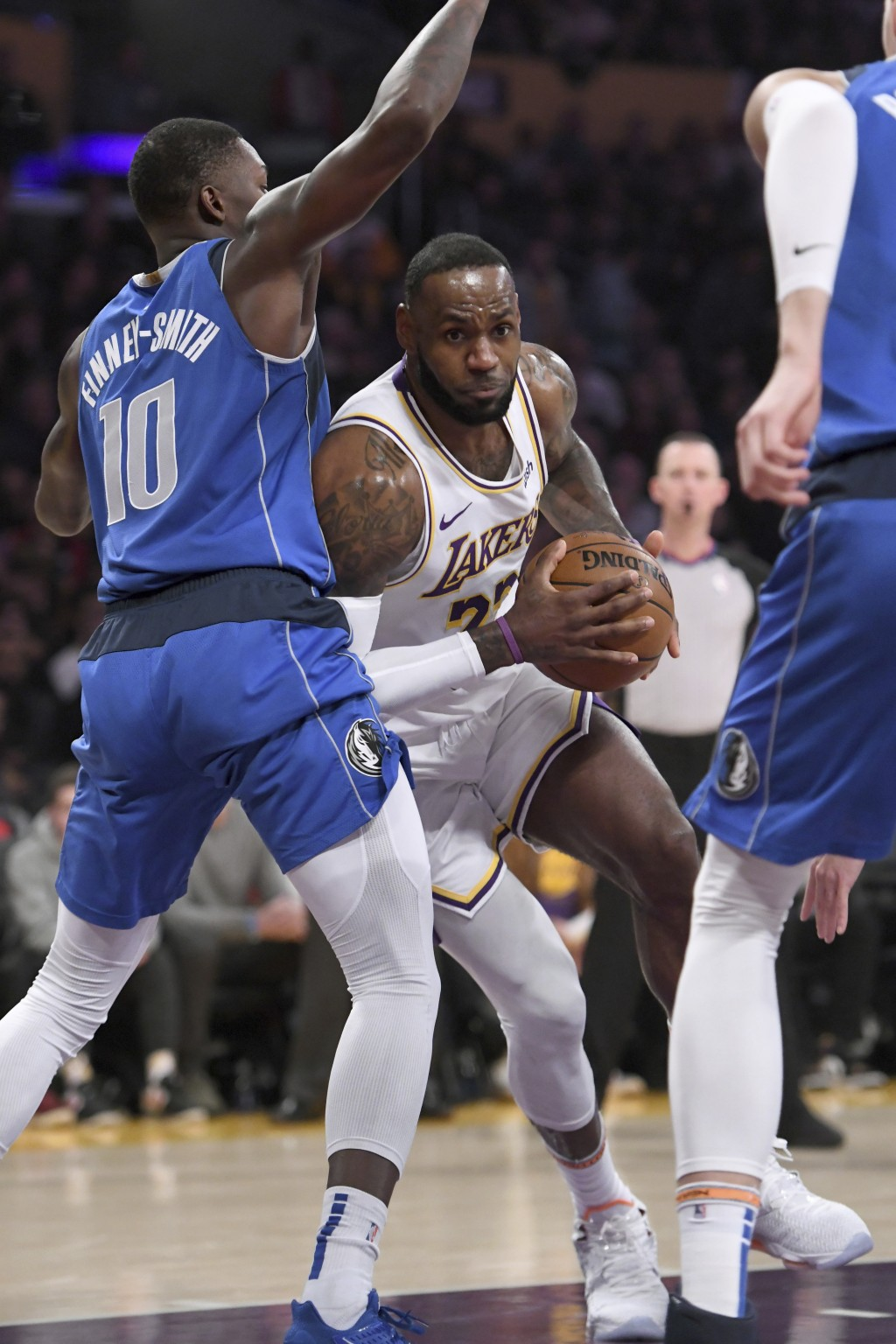 Los Angeles Lakers guard LeBron James drives to the basket against Dallas Mavericks forward Dorian Finney-Smith, left, during the first half of an NBA...
