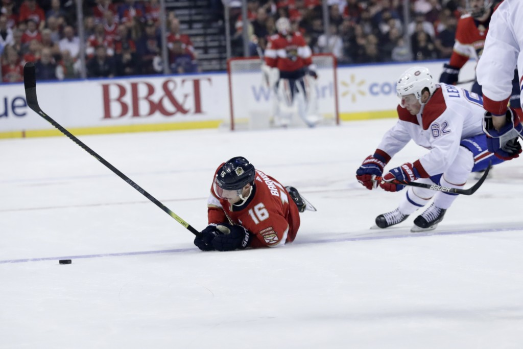 Florida Panthers center Aleksander Barkov (16) falls to the ice as Montreal Canadiens left wing Artturi Lehkonen (62) pursues during the first period ...