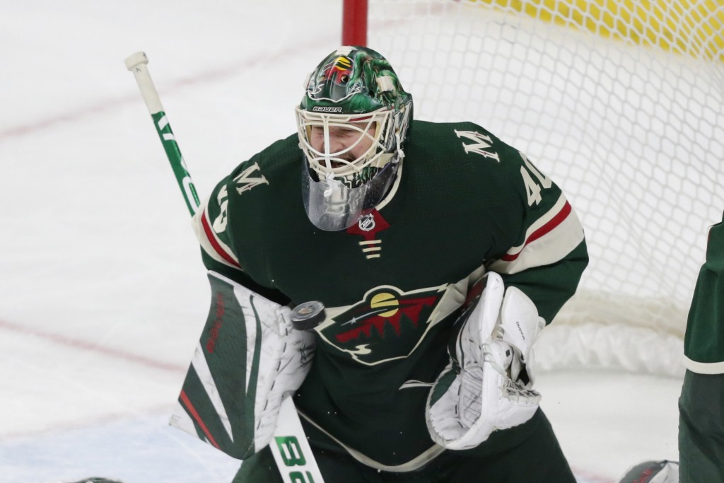 Minnesota Wild goalie Devan Dubnyk makes a save against the New York Islanders in the second period of an NHL hockey game Sunday, Dec. 29, 2019, in St...