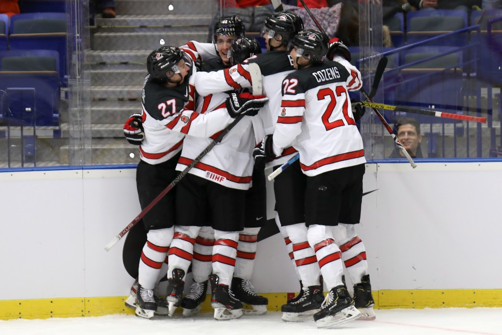 Nolan Foote, second from left, of Canada celebrates his goal with teammates during the 2020 IIHF World Junior Ice Hockey Championships Group B match b...