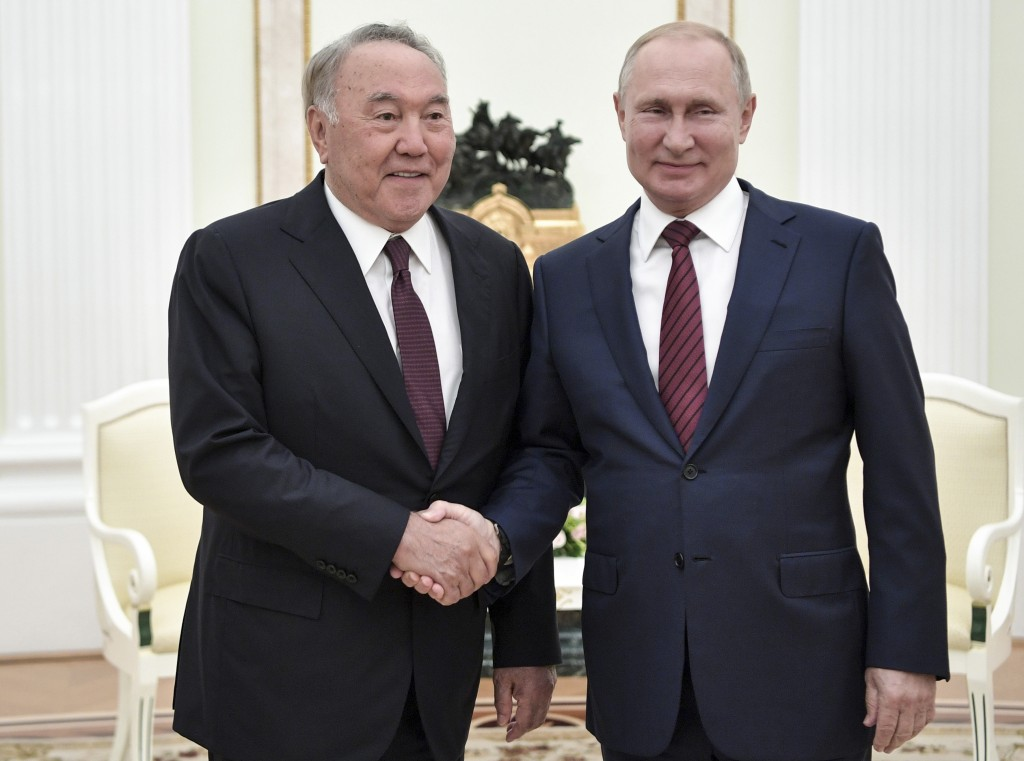 FILE In this file photo taken on Saturday, Sept. 7, 2019, Russian President Vladimir Putin, right, shakes hands with former President of Kazakhstan Nu...