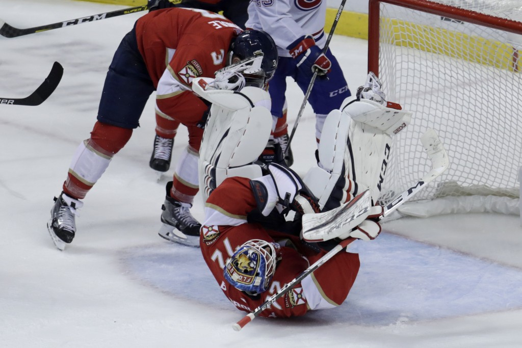 Florida Panthers goaltender Sergei Bobrovsky falls to the ice after making a save during the third period of an NHL hockey game against the Montreal C...