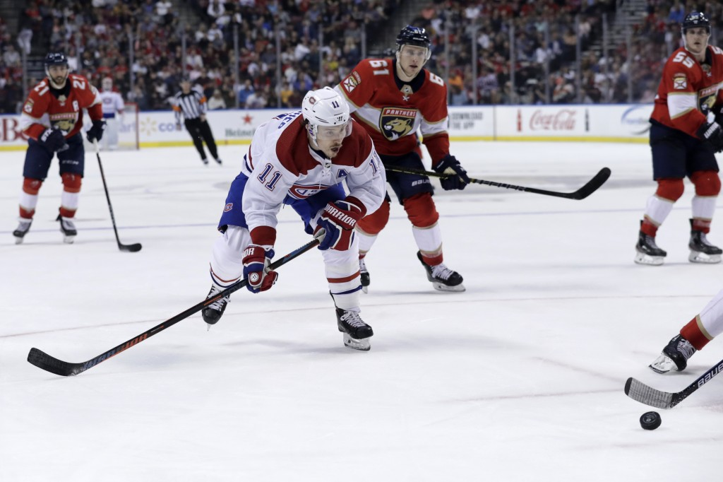 Montreal Canadiens right wing Brendan Gallagher (11) goes for the puck during the second period of an NHL hockey game against the Florida Panthers, Su...