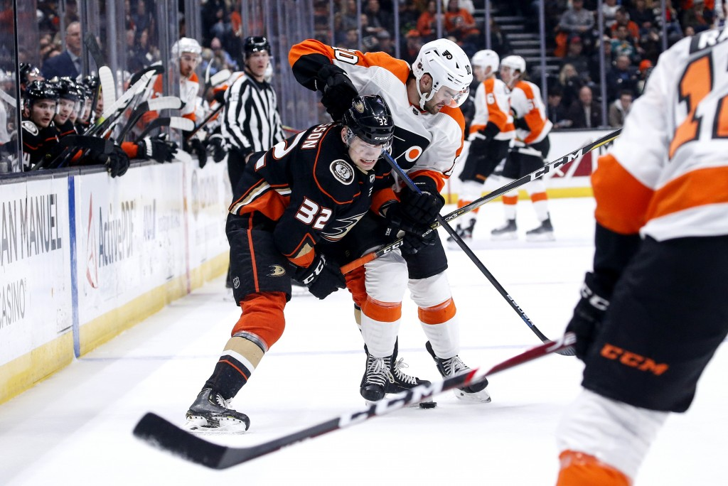 Anaheim Ducks defenseman Jacob Larsson (32) vies for the puck with Philadelphia Flyers forward Andy Andreoff (10) during the first period of an NHL ho...