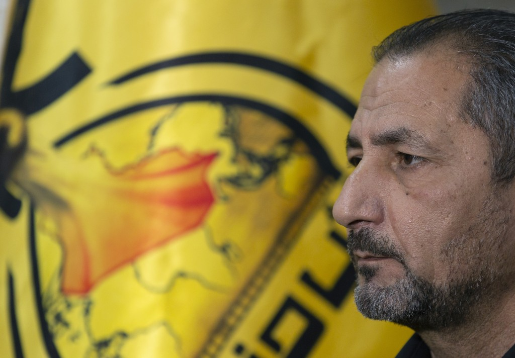 Mohammed Mohieh, the spokesman of Iraq's Iranian-backed Kataeb Hezbollah, or Hezbollah Brigades, gives an interview at his office, in Baghdad, Iraq, M...