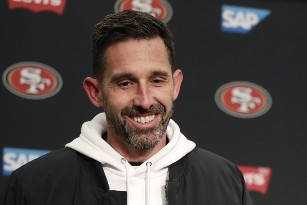 San Francisco 49ers head coach Kyle Shanahan smiles during a news conference after an NFL football game against the Seattle Seahawks, Sunday, Dec. 29,...