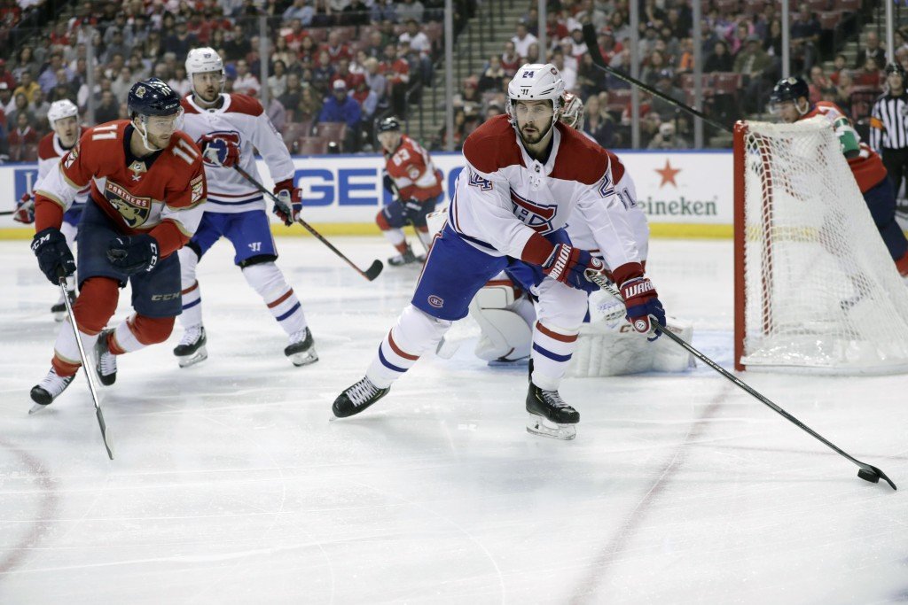 Montreal Canadiens center Phillip Danault (24) skates with the puck as Florida Panthers left wing Jonathan Huberdeau (11) defends during the first per...