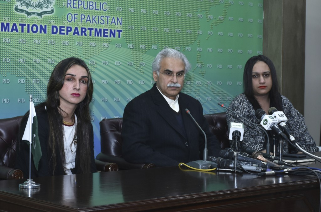 Dr. Zafar Mirza, center, Special Assistant to the Prime Minister on National Health, addresses a news conference with members of the Pakistani transge...