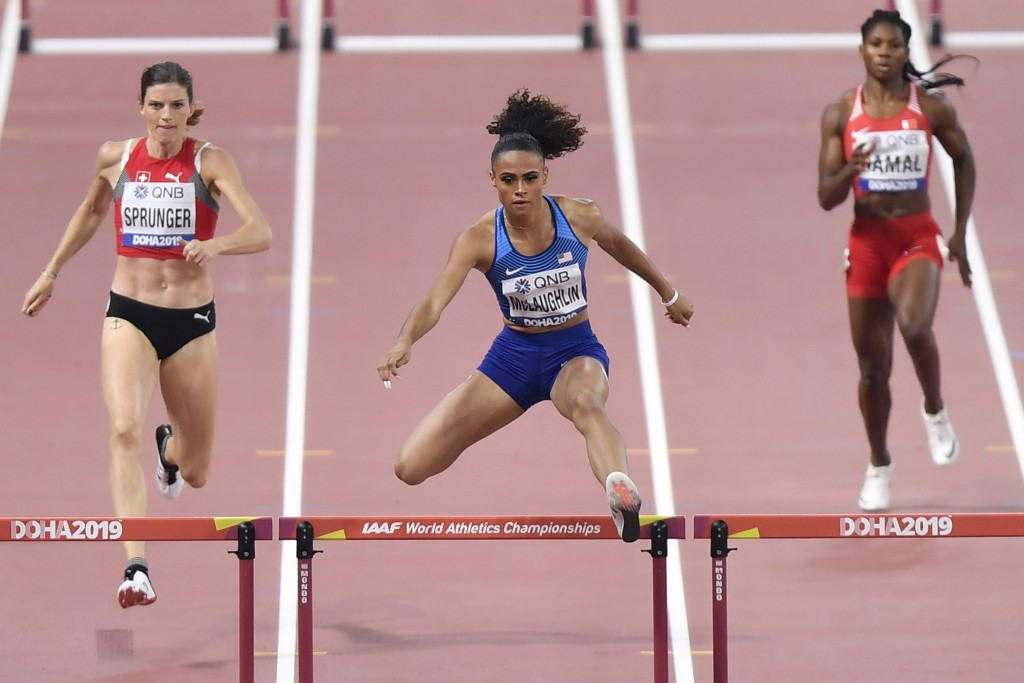 File-This Oct. 2, 2019, file photo shows Sydney McLaughlin of the United States, center, Lea Sprunger of Switzerland, left, and Aminat Jamal of Bahrai...