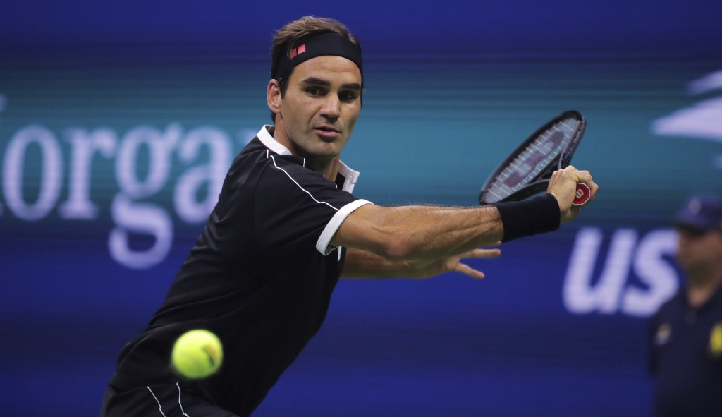 FILE - In this Sept. 3, 2019, file photo, Roger Federer, of Switzerland, chases a shot from Grigor Dimitrov, of Bulgaria, during the quarterfinals of ...