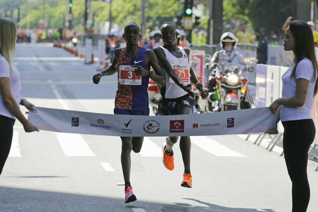 Kenya's Kibiwott Kandie, right, sprints to cross the finish line ahead of Uganda's Jacob Kiplimo during the Sao Silvestre race in Sao Paulo, Brazil, T...