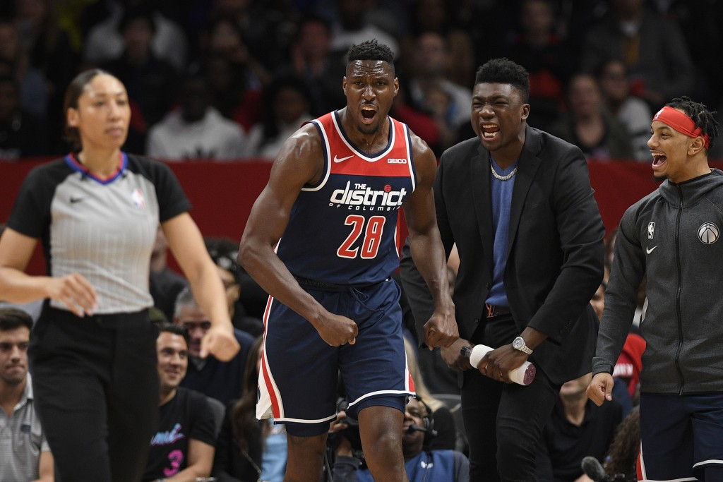 Washington Wizards center Ian Mahinmi (28) reacts during the first half of an NBA basketball game against the Miami Heat, Monday, Dec. 30, 2019, in Wa...