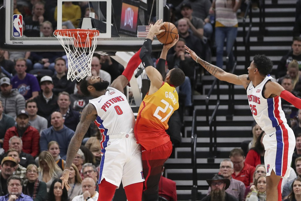 Detroit Pistons center Andre Drummond (0) blocks a shot by Utah Jazz center Rudy Gobert (27) while Pistons forward Christian Wood (35) follows during ...
