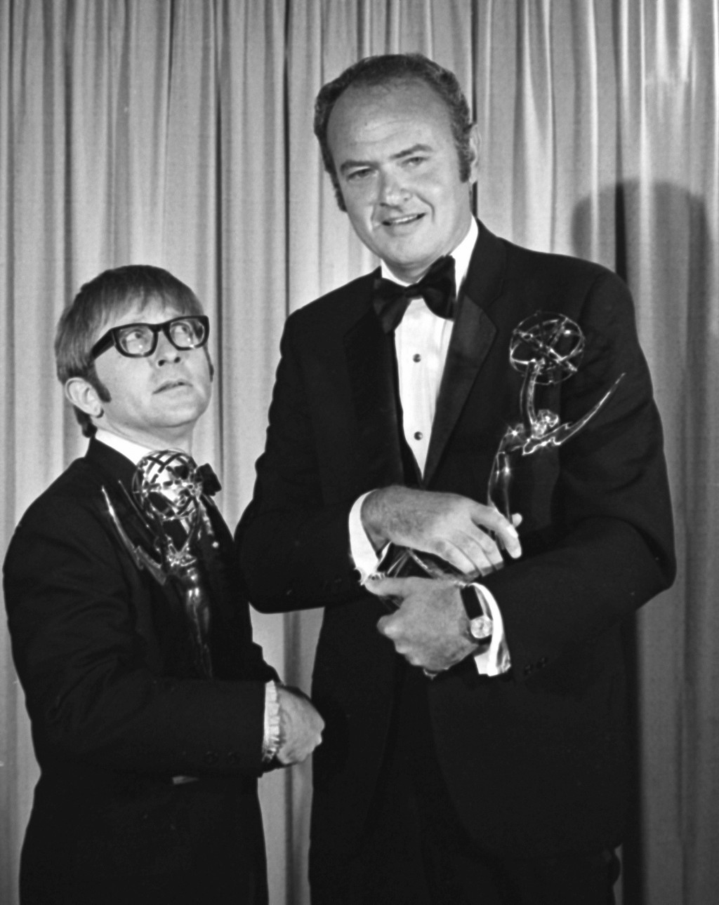 """Harvey Korman, right, of """"The Carol Burnett Show,"""" and Arte Johnson, of """"Rowan and Martin's Laugh-In,"""" hold their Emmys for Outstanding Individual Ach..."""