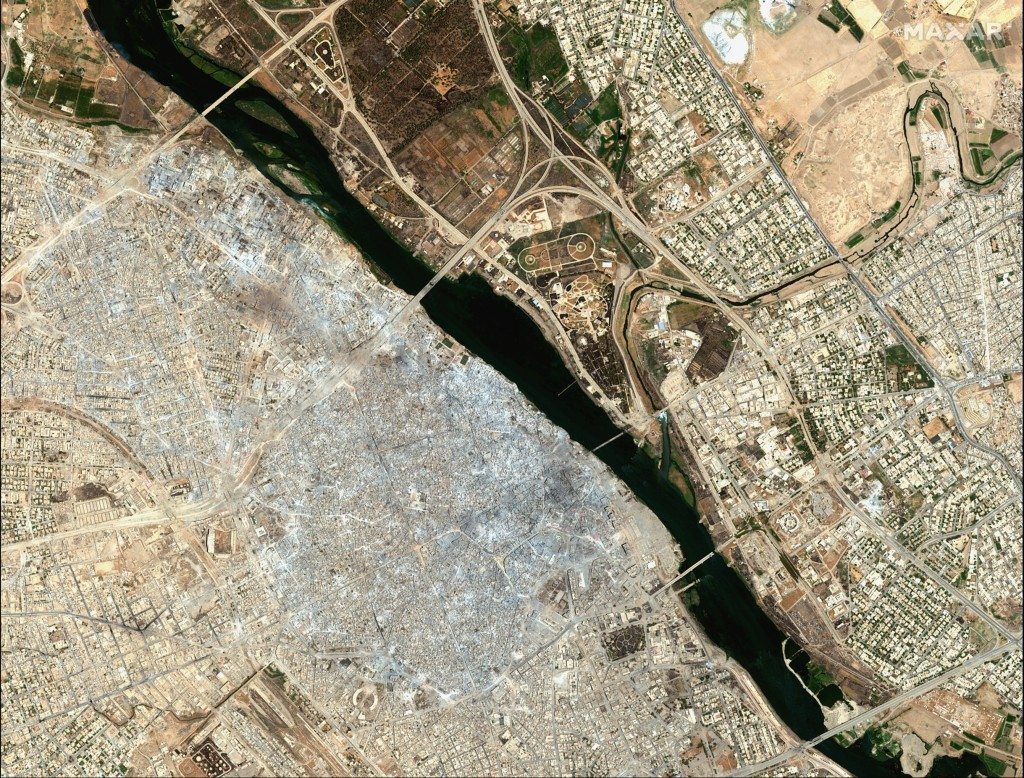 This July 8, 2017, image provided by Maxar Technologies shows the Old City of Mosul, Iraq, left, after a punishing nine month battle to oust Islamic S...