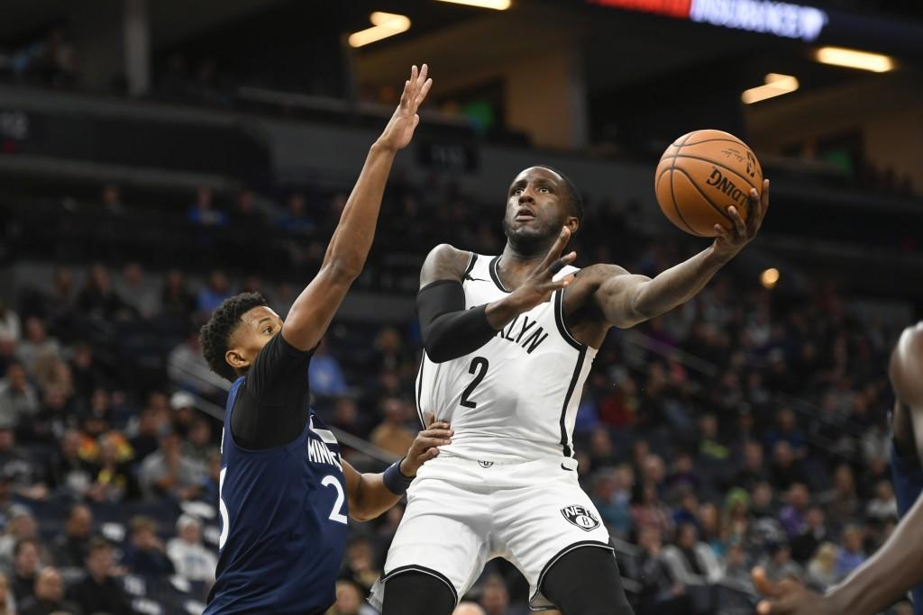 Brooklyn Nets forward Taurean Waller-Prince (2)goes around Minnesota Timberwolves guard Jarrett Culver to shoot during the first half of an NBA baske...