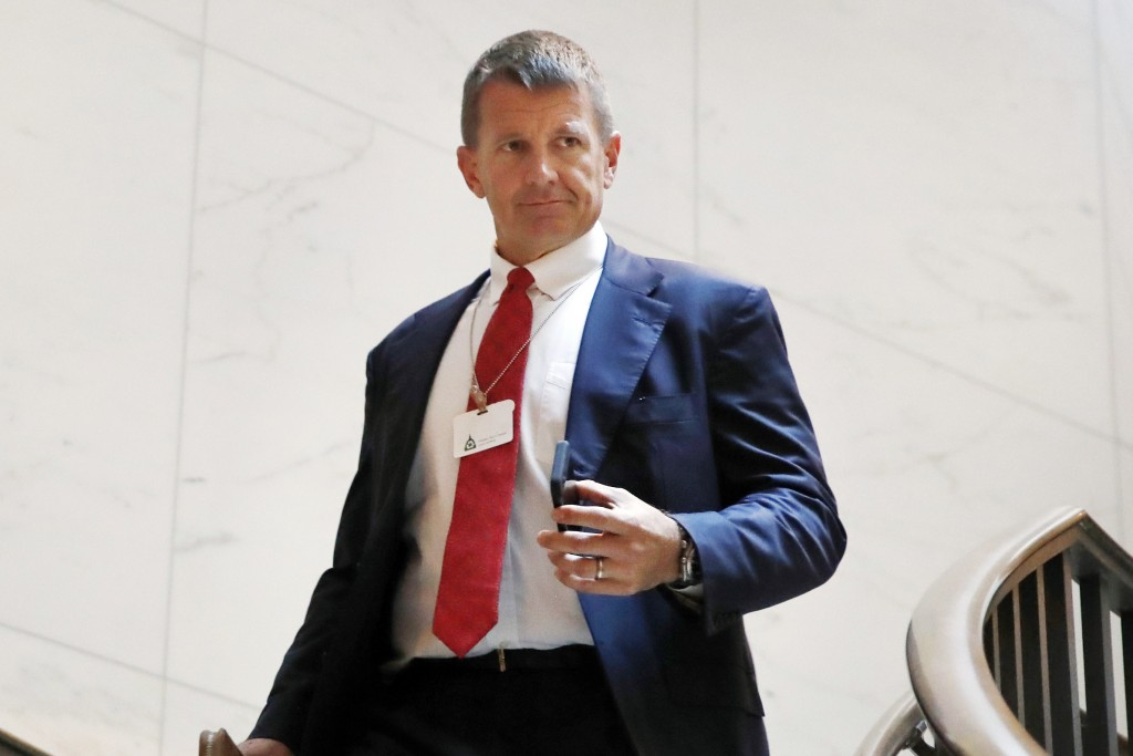 FILE - In this Nov. 30, 2017 file photo, Blackwater founder Erik Prince arrives for a closed meeting with members of the House Intelligence Committee ...