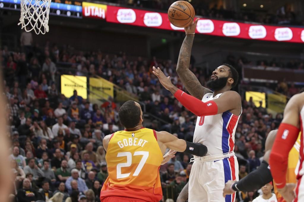 Detroit Pistons center Andre Drummond (0) shoots over Utah Jazz center Rudy Gobert (27) during the first quarter of an NBA basketball game, Monday, De...