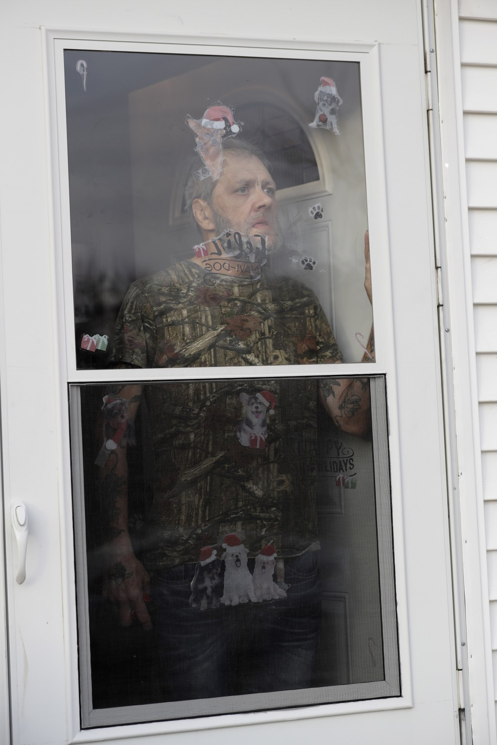 In this Friday, Dec. 20, 2019 photo, Bobby Goldberg looks outside from his home in suburban Chicago. Goldberg has filed a lawsuit claiming he was abus...