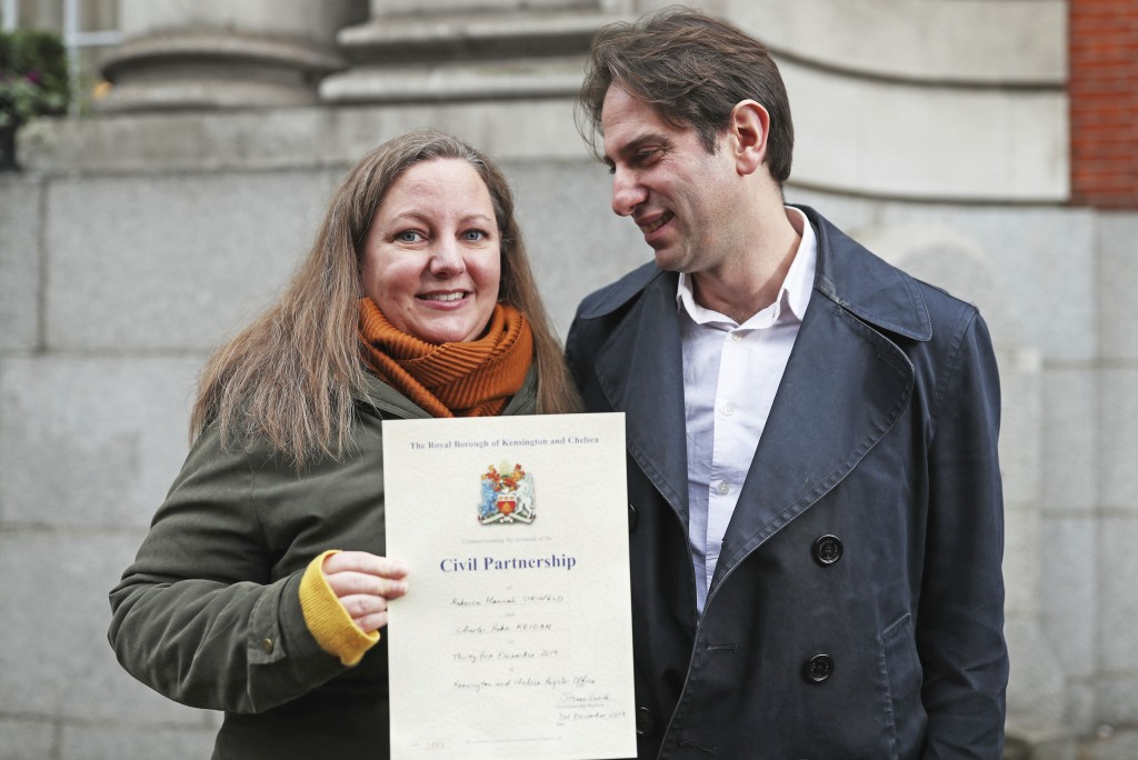 Rebecca Steinfeld and Charles Keidan pose for the media outside at Kensington and Chelsea Register Office after registering for a civil partnership, i...