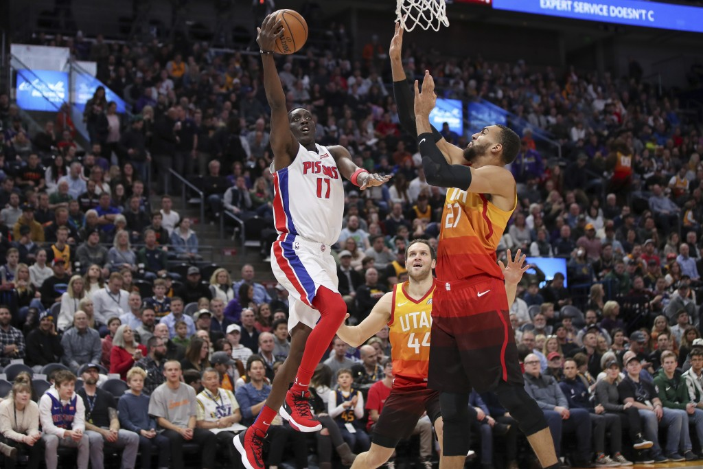 Utah Jazz center Rudy Gobert (27) tries to block the shot of Detroit Pistons guard Tony Snell (17) during the first quarter of an NBA basketball game,...