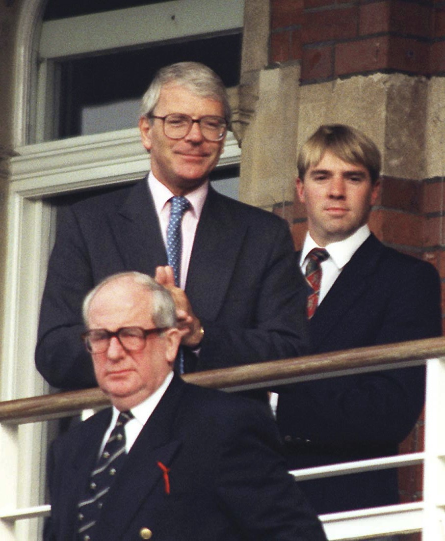 FILE - In this Aug. 25, 1996 file photo, Britain's Prime Minister at the time, John Major watches play at the Oval as Pakistan played England in the t...