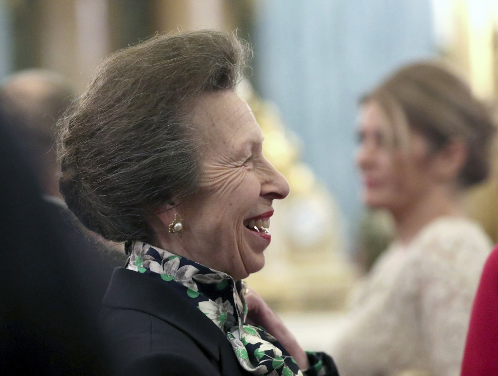 FILE - In this Tuesday, Dec. 3, 2019 file photo, Britain's Princess Anne talks to guests during a reception at Buckingham Palace, as NATO leaders gath...