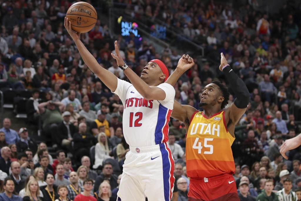 Detroit Pistons guard Tim Frazier (12) keeps the ball away from Utah Jazz guard Donovan Mitchell (45) while shooting the ball during the first quarter...