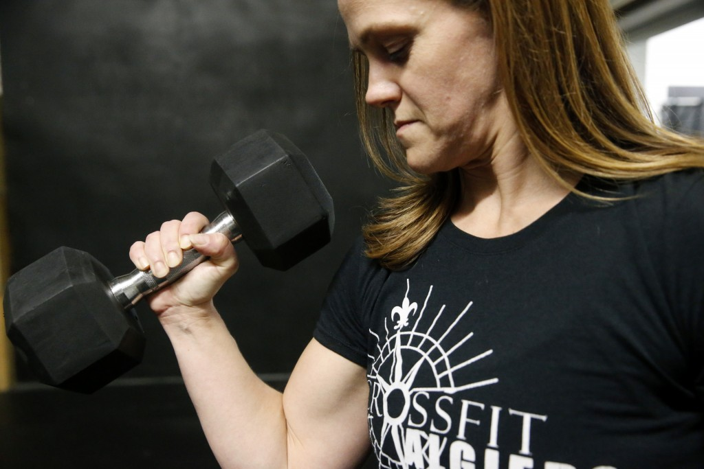 Melissa Breaux Bankston, a CrossFit athletic trainer at CrossFit Algiers in New Orleans, poses for a portrait at the gym Monday, Dec. 23, 2019. She pa...