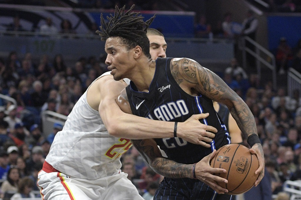 Orlando Magic guard Markelle Fultz (20) is fouled by Atlanta Hawks center Alex Len (25) while driving to the basket during the second half of an NBA b...