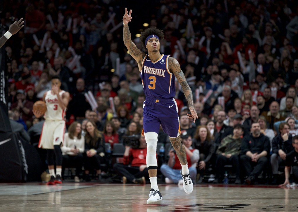 Phoenix Suns forward Kelly Oubre Jr. reacts after making a 3-point basket against the Portland Trail Blazers during the second half of an NBA basketba...
