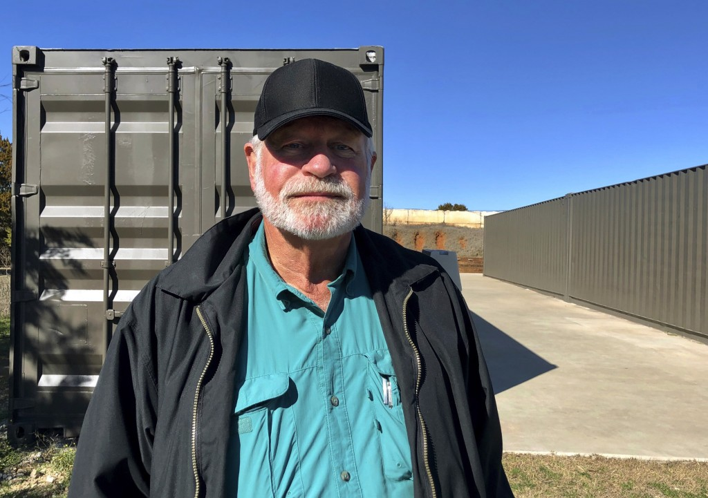 Jack Wilson, 71, poses for a photo at a firing range outside his home in Granbury, Texas, Monday, Dec. 30, 2019. Wilson trains the volunteer security ...