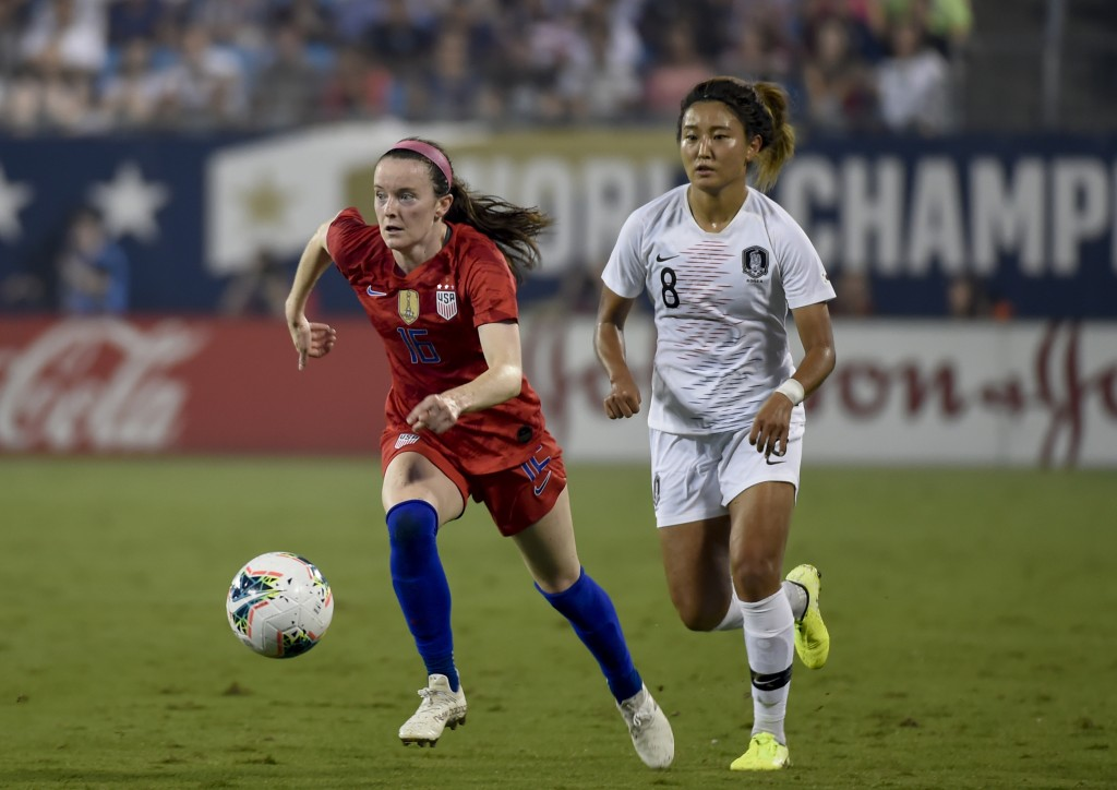 File-This Oct. 3, 2019, file photo shows United State's Rose Lavelle, left, dribbles past South Korea's Cho So-hyun, right, during a soccer match in C...