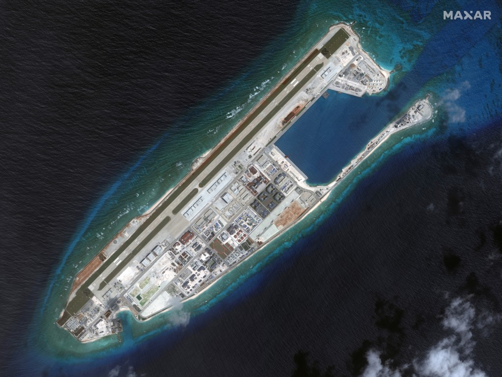 This March 2017 image provided by Maxar Technologies shows a satellite image of Fiery Cross Reef in Spratly island chain in the South China Sea. (Sate...