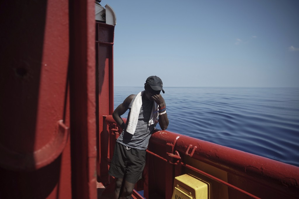 In this Sept. 14, 2019 photo, Amidou from Cameroon touches his face aboard the Ocean Viking humanitarian ship as it sails to Italy in Mediterranean Se...