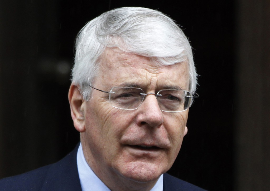 FILE  - In this Tuesday, June 12, 2012 file photo, former British Prime Minister John Major arrives to give evidence to the Leveson inquiry at the Roy...