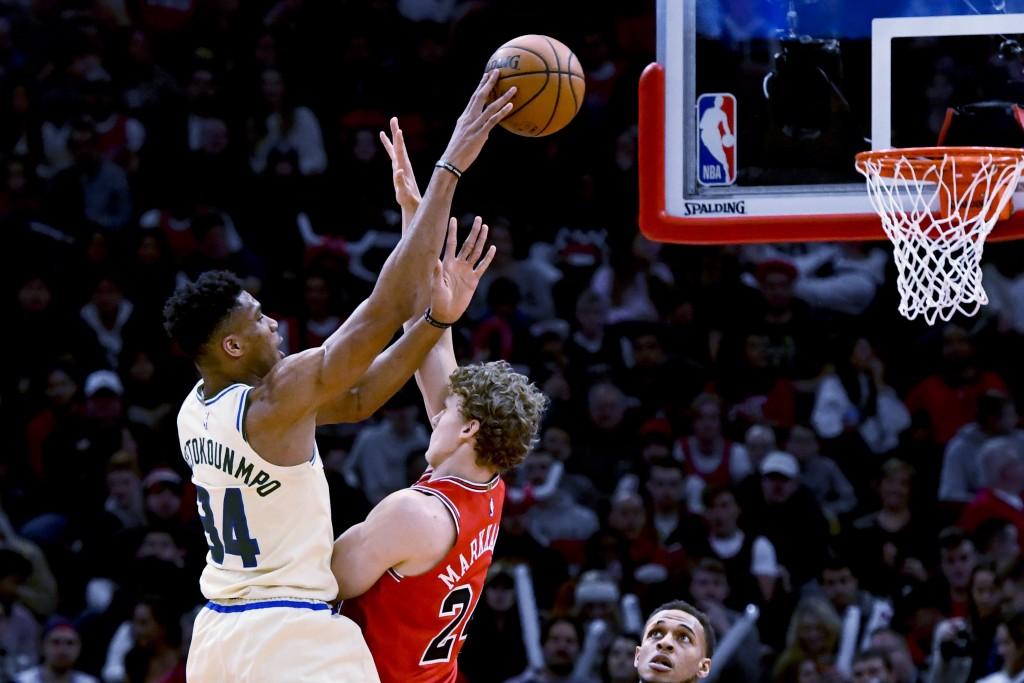 Milwaukee Bucks forward Giannis Antetokounmpo (34) shoots over Chicago Bulls forward Lauri Markkanen (24) during the first half of an NBA basketball g...