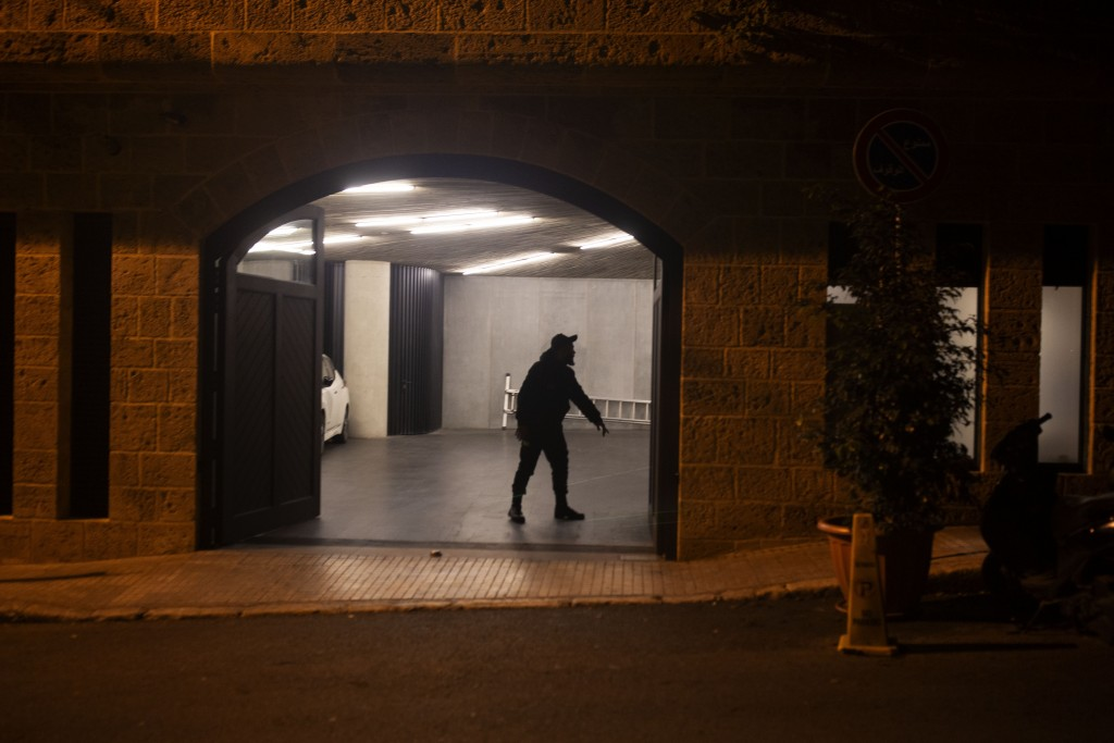 A security guard stands in the garage at the residence of former Nissan Chairman Carlos Ghosn on Monday, Dec. 30, 2019 in Beirut, Lebanon. A close fri...