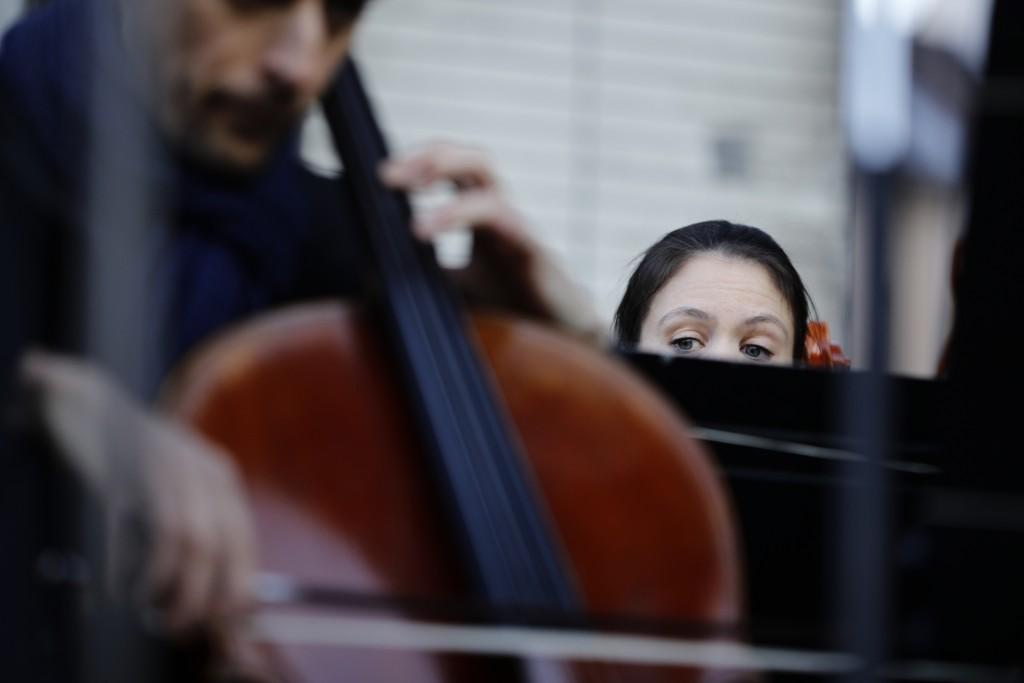 Striking musicians of the Paris Opera house perform outside the Bastille Opera house Tuesday, Dec. 31, 2019 in Paris. (AP Photo/Kamil Zihnioglu)