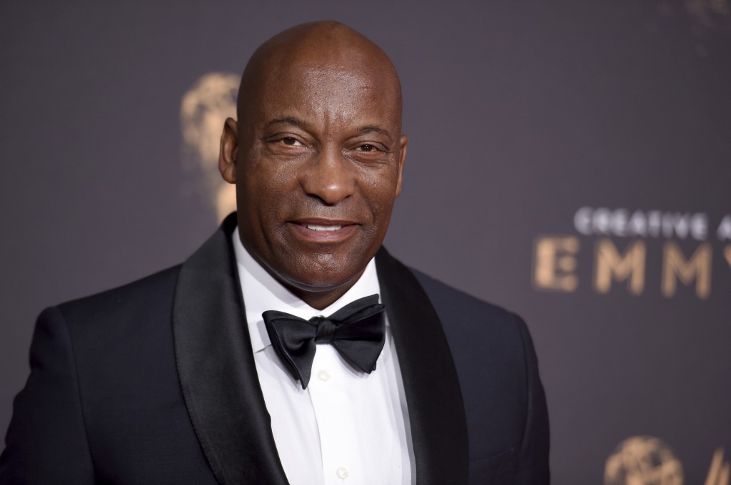 Director John Singleton arrives at the Creative Arts Emmy Awards  in Los Angeles on Sept. 9, 2017.  A director who made one of Hollywood's most memora...